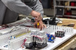 components being assembled in control panel manufacturing