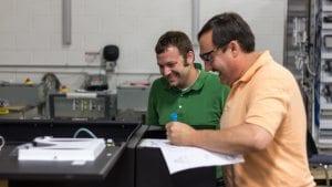 engineers developing a custom control panel